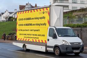 Covid-warning-truck-advert